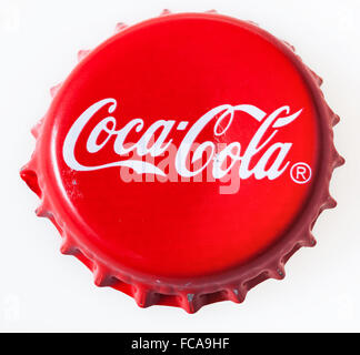 MOSCOW, RUSSIA - DECEMBER 12, 2105: top view of used red cap from the glass bottle of Coca-Cola. The Coca-Cola Company - Stock Photo