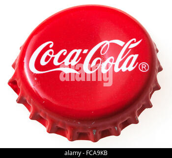 MOSCOW, RUSSIA - DECEMBER 12, 2105: above view of used red cap from the glass bottle of Coca-Cola. The Coca-Cola - Stock Photo