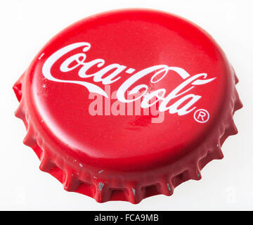 MOSCOW, RUSSIA - DECEMBER 12, 2105: Used red cap from the glass bottle of Coca-Cola. The Coca-Cola Company is an - Stock Photo