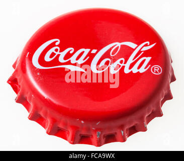 MOSCOW, RUSSIA - DECEMBER 12, 2105: Used red crown cap from the bottle of Coca-Cola soft drink. The Coca-Cola Company - Stock Photo