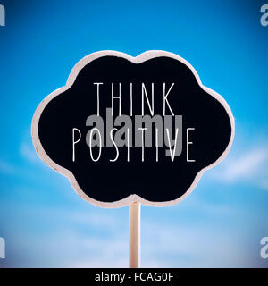 a chalkboard in the shape of a thought bubble with the text think positive written in it against the sky, with a - Stock Photo