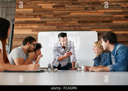 brainstorming-in-a-boardroom-of-creative