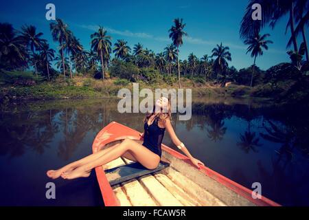 woman posing on boat - Stock Photo