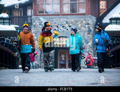Athletes walking in Ski Resort Base Area - Stock Photo