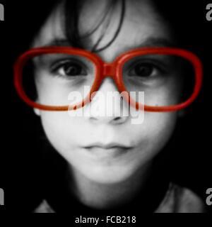 Boy Wearing Large Red Rimmed Eyeglasses - Stock Photo