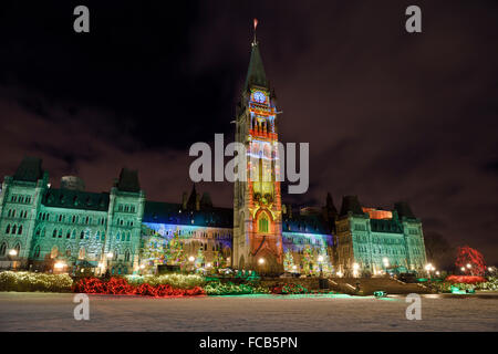 Christmas Light Show at Canadian Parliament Buildings Center Block at Parliament Hill Ottawa Canada in winter at - Stock Photo