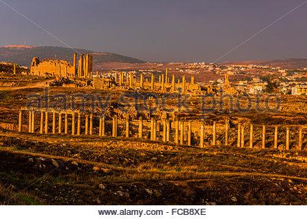 Ruins of the Greco-Roman city of Gerasa, with the modern city of Jerash behind (near Amman), Jordan. - Stock Photo