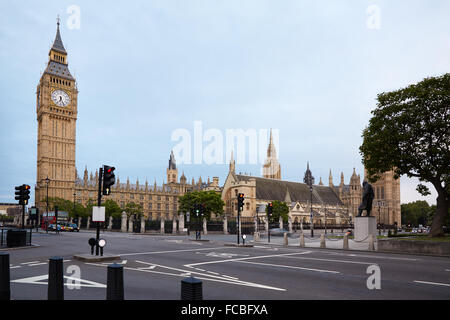 Big Ben and Houses of Parliament in the early morning, empty street in London - Stock Photo
