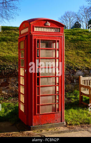 A rural British red traditional telephone box. In Wymeswold, England on 15th January 2016. - Stock Photo