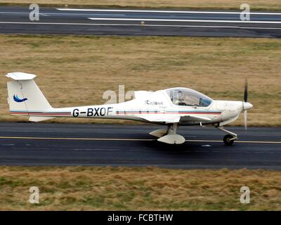 This Katana of the Cumbernauld Flying School, is seen as it taxis in after a training flight at Prestwick Airport. - Stock Photo