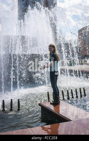 Portrait Of A Teenage Girl In Front Of Fountain - Stock Photo