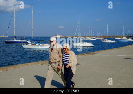 old elderly senior couple walking healthy living - Stock Photo