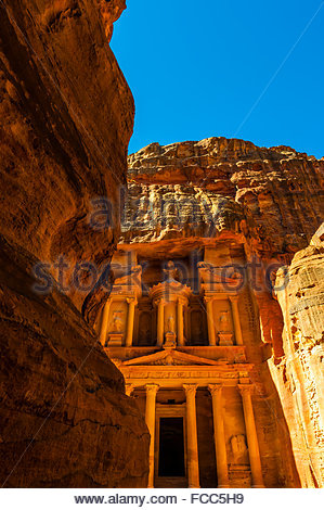 Looking from The Siq (gorge) to The Treasury (Al-Khazneh), Petra Archaeological Park (a UNESCO World Heritage Site), - Stock Photo