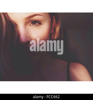 Close-Up Of A Beautiful Young Woman Over Black Background - Stock Photo