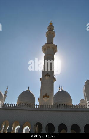 Minaret Of Sheikh Zayed Grand Mosque Against Clear Blue Sky - Stock Photo