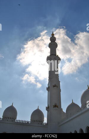Minaret Of Sheikh Zayed Grand Mosque Against Cloudy Sky - Stock Photo