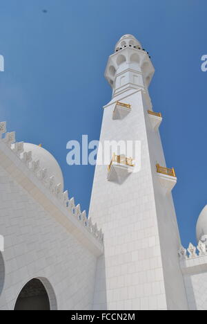Low Angle View Of Grand Mosque Minaret Against Clear Blue Sky - Stock Photo