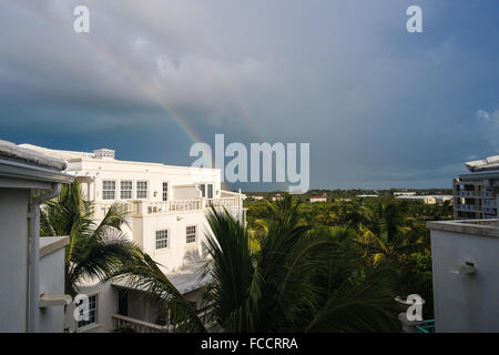 Rainbow Against Cloudy Sky - Stock Photo
