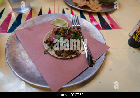 Traditional Mexican pollo chicken soft taco served at Tacombi, New York - Stock Photo