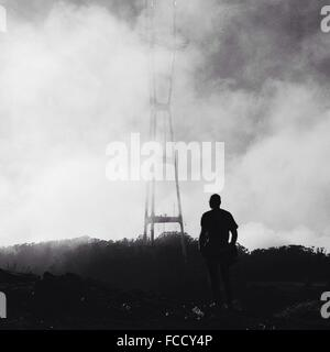 Man Standing Among Smoke - Stock Photo