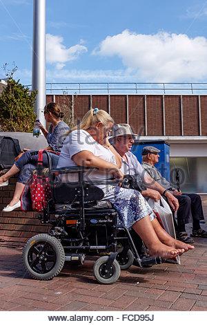 Older couple talking, Poole highstreet, Dorset England UK - Stock Photo