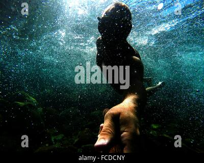 Man Swimming In Sea - Stock Photo