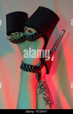Close Up Of Women's Legs In Bizarre Shoes - Stock Photo