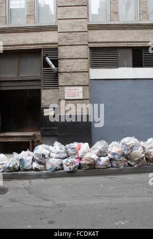 Heap Of Garbage Bags On Sidewalk By Street - Stock Photo