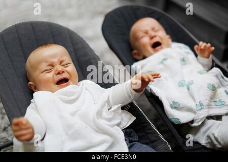 8 months baby boy twins crying - Stock Photo