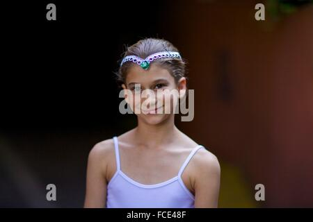 Portrait of a young girl wearing a ballet suit - Stock Photo
