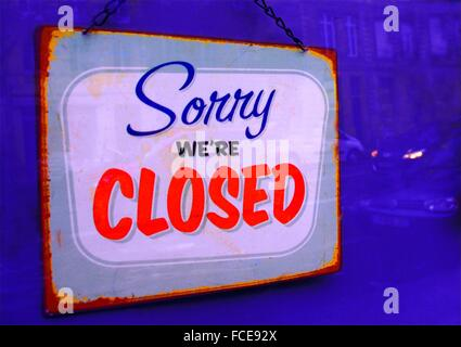 CLOSED sign on a shop door - Stock Photo