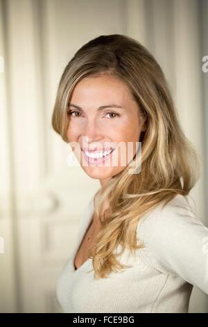 Close-up of young woman smiling - Stock Photo