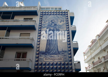 St Francis of Assisi (Sao Francisco de Assis) mural on the side of a building in Faro, Portugal. Stock Photo