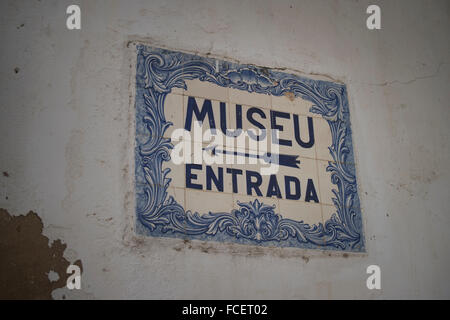 museum entrance, museu entrada, sign in blue and white ceramic tiles on a wall in Lagos, Portugal - Stock Photo