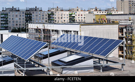Solar panels on the top of a building - Stock Photo