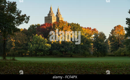 Central Park Sheep Meadow in full autumn colors with The San Remo towers in sunrise light. Fall in Manhattan, New - Stock Photo