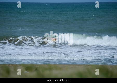Bodyboarding surfer in Dorado beach. Dorado, Puerto Rico. Caribbean Island. US territory. - Stock Photo