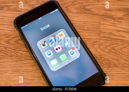 Social media apps with notifications on Apple iPhone 6 Plus smartphone  Model Release: No.  Property Release: No. - Stock Photo