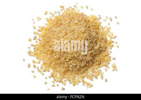 Heap of raw Bulgur on white background - Stock Photo