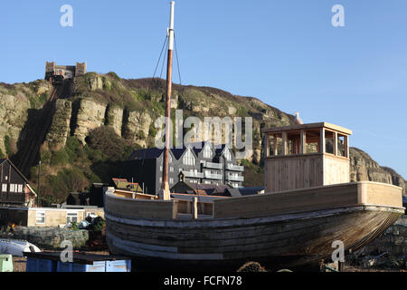 Fishing boats on the Stade with the East Hill lift in the background, Hastings, East Sussex, UK - Stock Photo