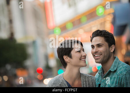 A couple, man and woman on a city street. - Stock Photo