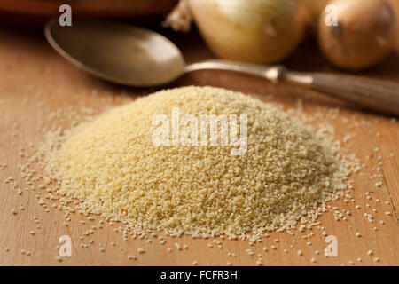 Raw couscous grains, popular food in North African countries - Stock Photo