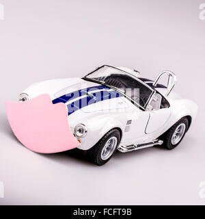 beautiful blue and white car, roadster with pink kiss, valentine car - Stock Photo