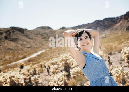 A young woman in a desert landscape. - Stock Photo
