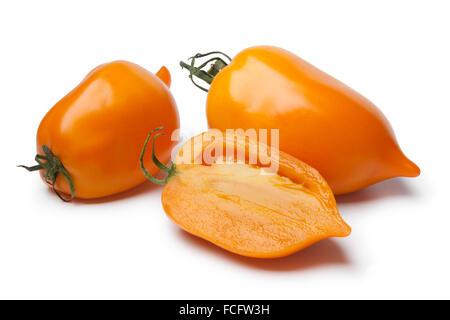 Whole and half fresh orange pepper- tomatoes on white background - Stock Photo