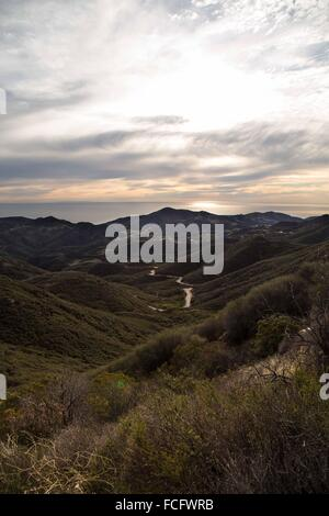 View of pacific ocean and green valley on the backbone trail in Ventura, Valley, California. - Stock Photo