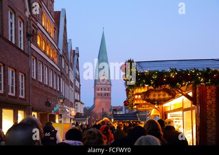 St. Johannis Church during a Christmas Market with crowd of people, old houses and Christmas decoration, Lueneburg, - Stock Photo
