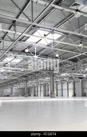 Interior of big empty storehouse - Stock Photo