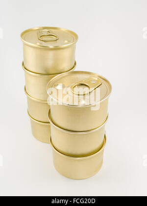 Seven gold blank cat food cans with pull tab piled on top of each other against a white background. - Stock Photo