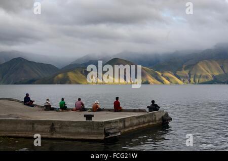 Fisher men Lake Toba Sumatra - Stock Photo